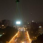 Egyptian protestors direct laser lights on a military helicopter flying over the presidential palace in Cairo.