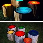 Log stools painted to glow in the dark.