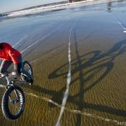 Winter cycling over a frozen lake in Michigan