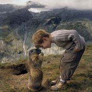 An adorable little boy, a curious marmot, and a dramatic landscape.