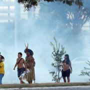 Indigenous people in Brazil shooting arrows at the police to protest against the worldcup