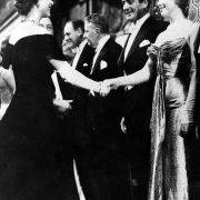 Marilyn Monroe and Queen Elizabeth (both 30 at the time) meet at a movie premier in London. October 1956.