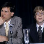 Steve Jobs of Apple answers a question while sitting next to Bill Gates of Microsoft at an interview in New York, 1984