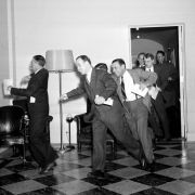 White House reporters dash for the telephones after they had been told by presidential press secretary Stephen T. Early that Japanese submarines and planes had just bombed the U.S. Pacific fleet at Pearl Harbor, December 7, 1941