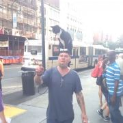 Just an angry guy with a cat on his head.