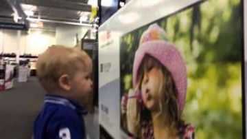 Kid lands the cutest first kiss ever