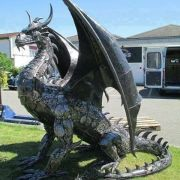 A dragon made out of car parts