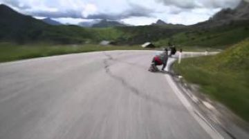 Skateboarders racing cyclists in the ALPS. Byron Essert and Alex Tongue going hard yet