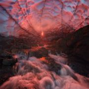Inside a Dragon's belly. Or an ice cave under a volcano in Kamchatka.