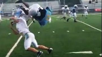 High School Football Player Flips Over Defender