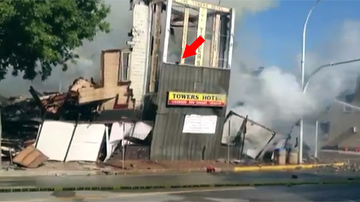 Scared kitty escapes collapsing building that was on fire.