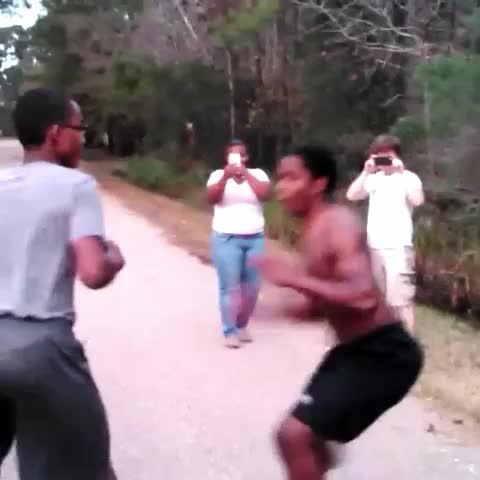 Kid with glasses gets slammed my shirtless dude.