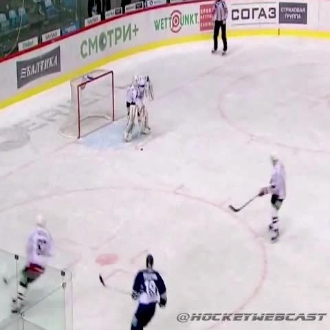 Watch goalie go for the empty net just to be stonewalled by Superman mid-air (@HockeyWebCast)