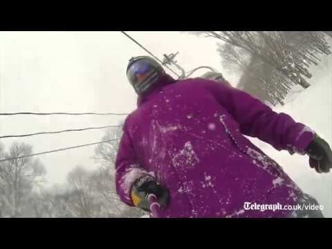 Snowboarder gets hit by a chairlift while selfie stick filming