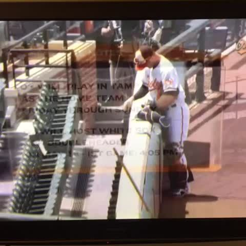Caleb Joseph signing fake autographs and taking fake applause as he heads out onto the field in Baltimore