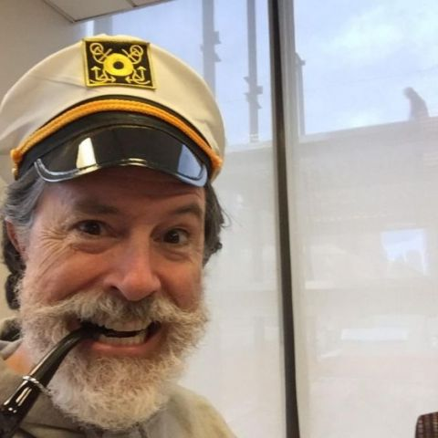 Stephen Colbert rocking a white beard and Captain hat