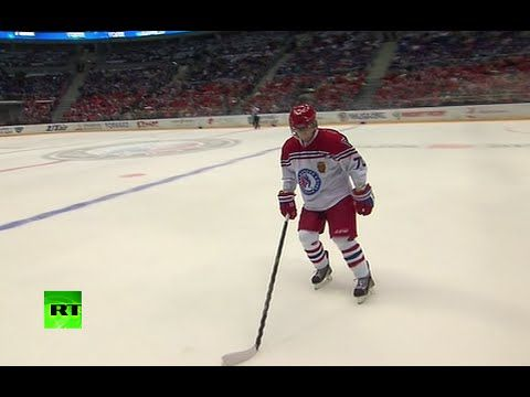 Putin hits the ice for hockey match in Sochi