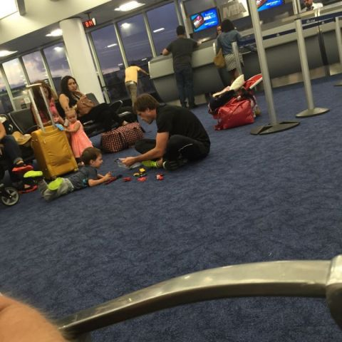 Flight to Cancun was delayed after 3 hours for plane issues. Everyone is pissed. This guy just gets on the floor and plays cars with his son. I can't be mad anymore.