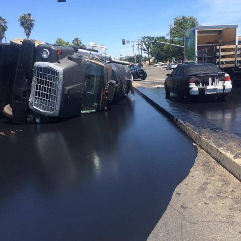 Truck with asphalt sealant tipped over today