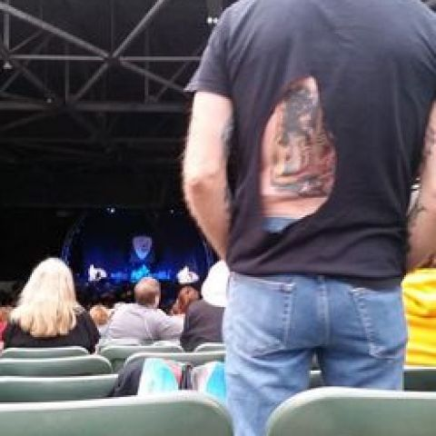 This guy cut a hole in his shirt so everyone at the Van Halen show could see his Eddie tattoo