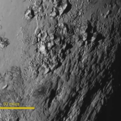 First detailed closeup of Pluto, at 0.4 km/pixel.