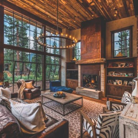 Large living area with floor-to-ceiling windows in a home in Lake Tahoe, California.