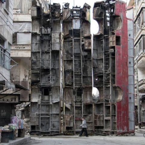 Buses placed vertically on the street in Aleppo, Syria to protect against snipers
