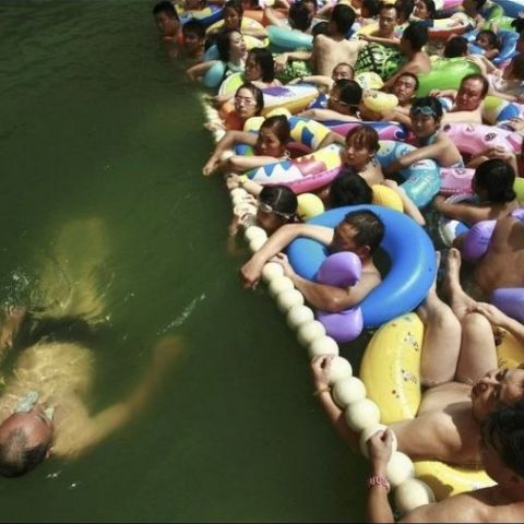 In China, You Can Pay Extra To Get in the uncrowded section of the swimming area. This is the result.