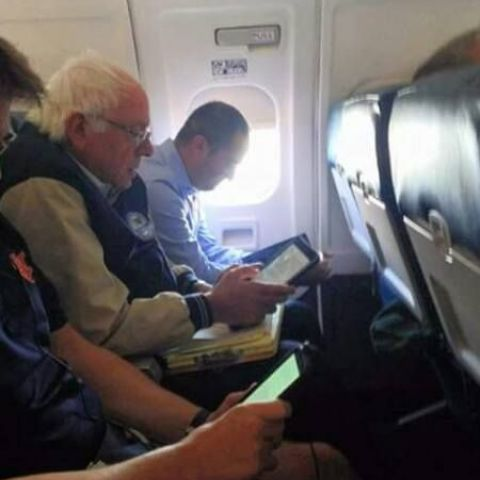 Bernie Sanders working while flying coach. The people's champion!