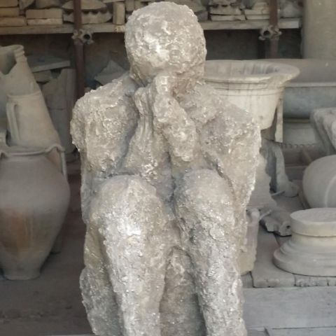Man trying to cover his face, Pompeii