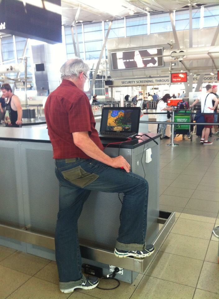 This guy at the Airport playing Age of Empires on his knee.