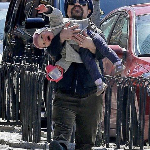 Just thought you guys might like a picture of Peter Dinklage holding his baby