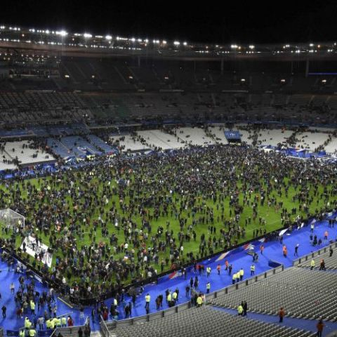 Spectators moved onto the field of the Stade de France in Saint-Denis, north of Paris. Nov. 13, 2015