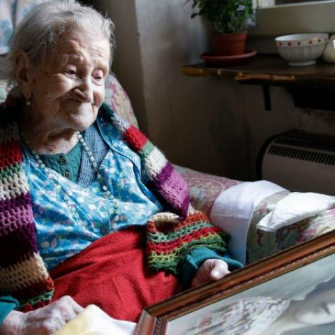 116 y/o Emma Morano looking at a much younger portrait of herself