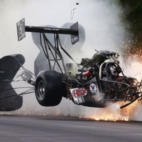 NHRA driver Larry Dixon crashes after his car broke in half during qualifying for the Gatornationals at Auto Plus Raceway in Gainesville, Florida. Dixon walked away from the incident; Mark J. Rebilas