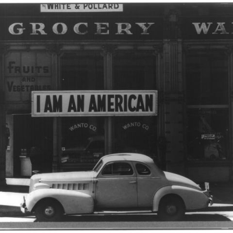 """I am an American"" sign placed in the window of an Oakland, CA store the day after Pearl Harbor. The store was closed in 1942, when the owner was relocated to an internment camp."