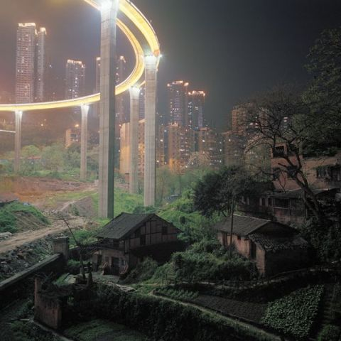 The Caiyuanba Bridge, completed in 2007, contrasts with the more rural outskirts of Chongqing, China; Mark Horn