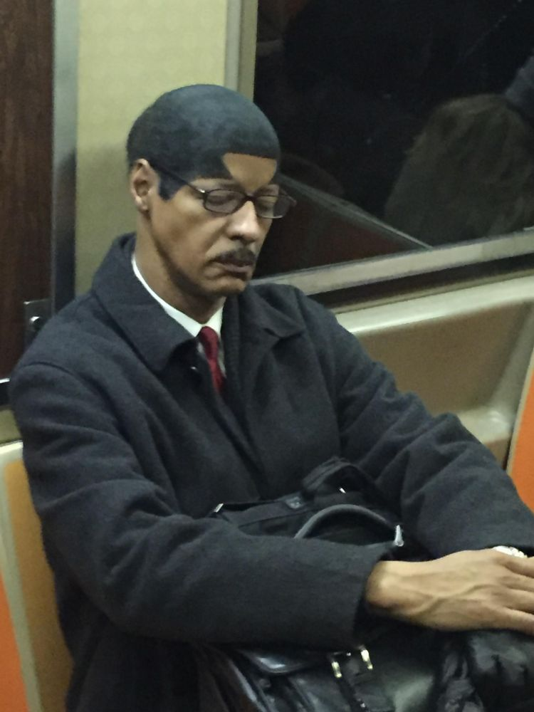Guy with a Sharpie'd hairline on a NYC subway