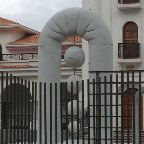 This world peace sculpture looks suspiciously like anal beads coming out of a flappy butt.